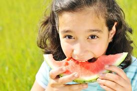 Girl-eating-watermelon-outside