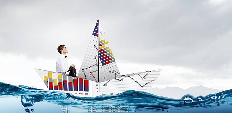 Man-Afloat-Paper-Sailboat-Financial-Charts