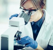 Laboratory Technician with Microscope